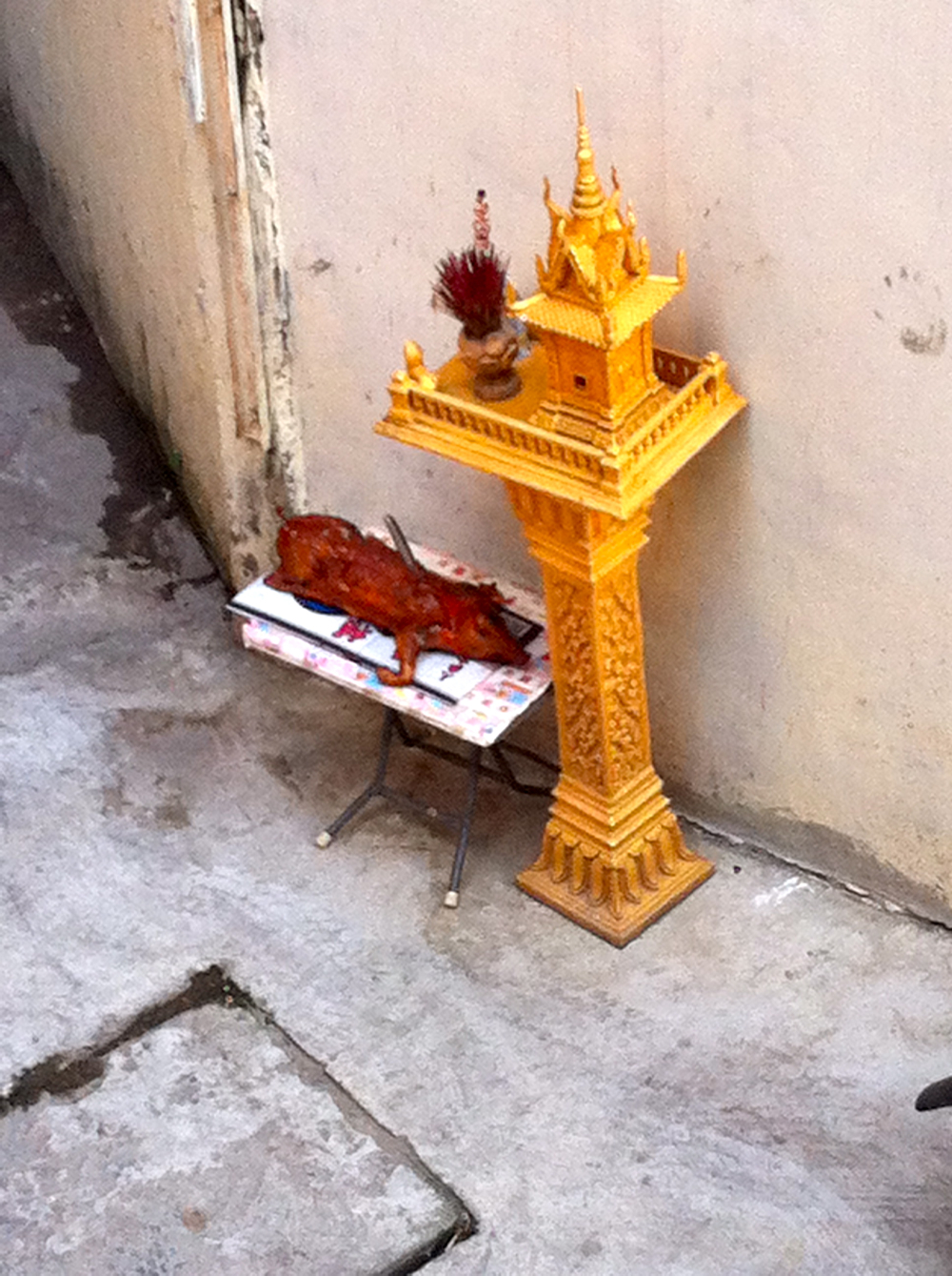 Spirit house pork pig offering