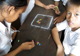 Kids playing a Flick Game