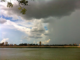 Half rain, half sunshine over Tonle Sap.