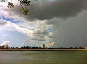 Half rain, half sunshine over Tonle Sap.