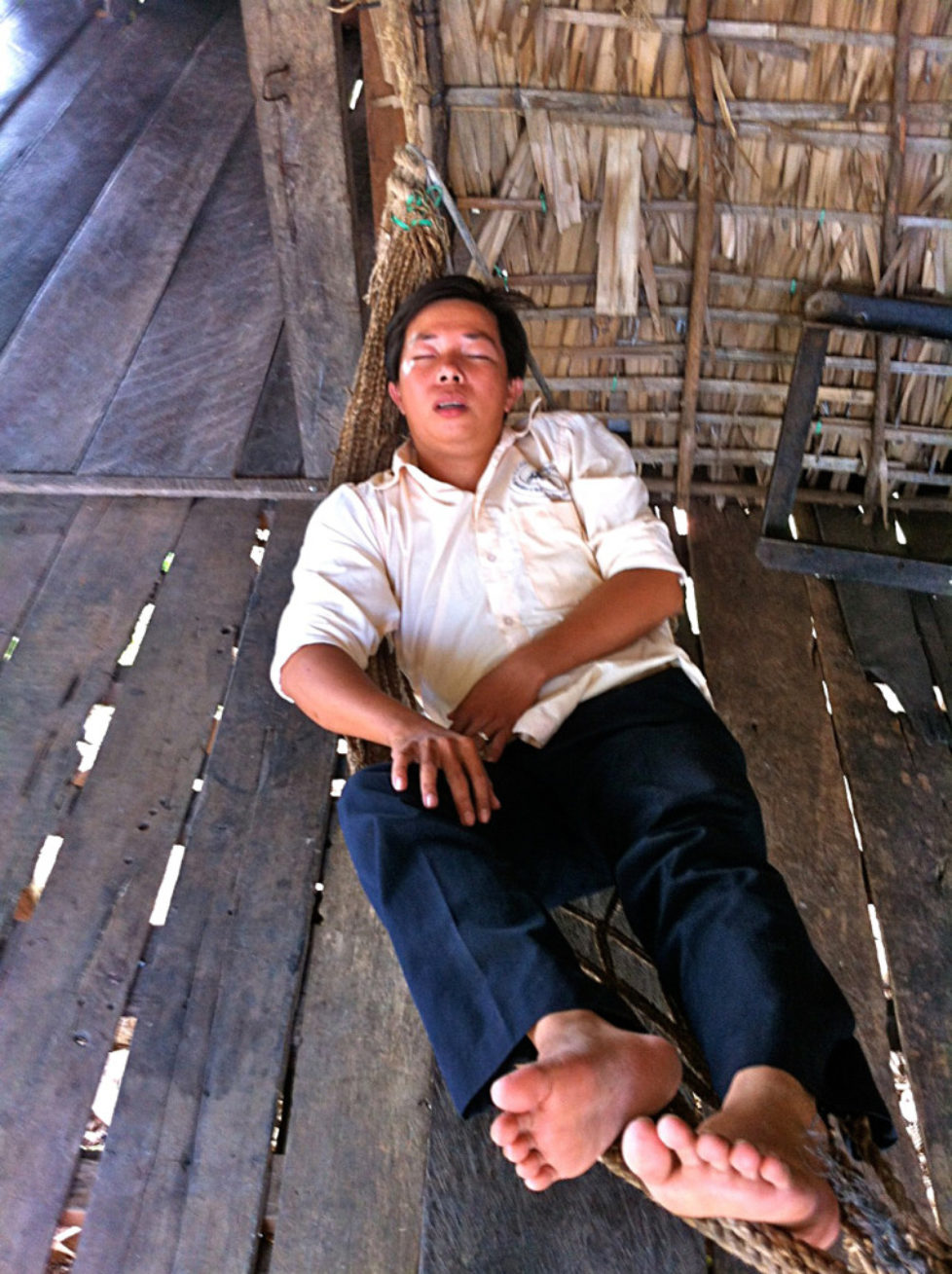 Cambodian Moments Sleeping by Tonle sap